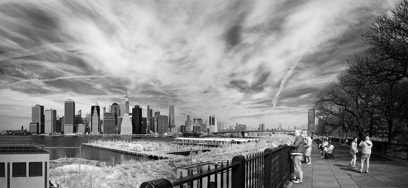 Infrared Panoramic Photograph of Manhattan and the Brooklyn Heights Promenade With People Enjoying the Space and View.