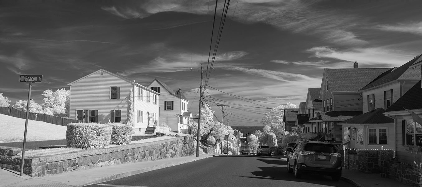 Infrared Photo of New England Street Running Down to a Harbor on a Sunny Day.