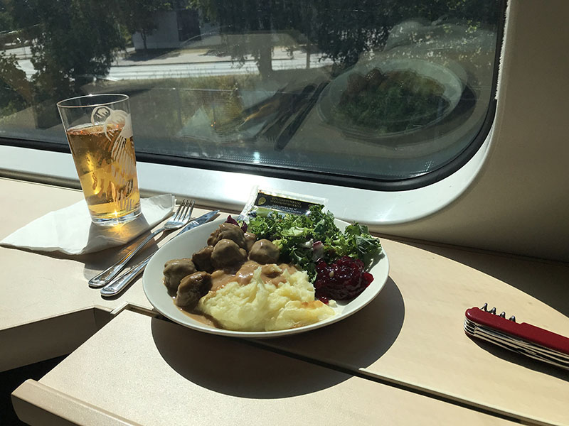 Great Looking Sunlit Meal on Finnish VR Train, Meatballs and Lingonberry Jam and Cider.