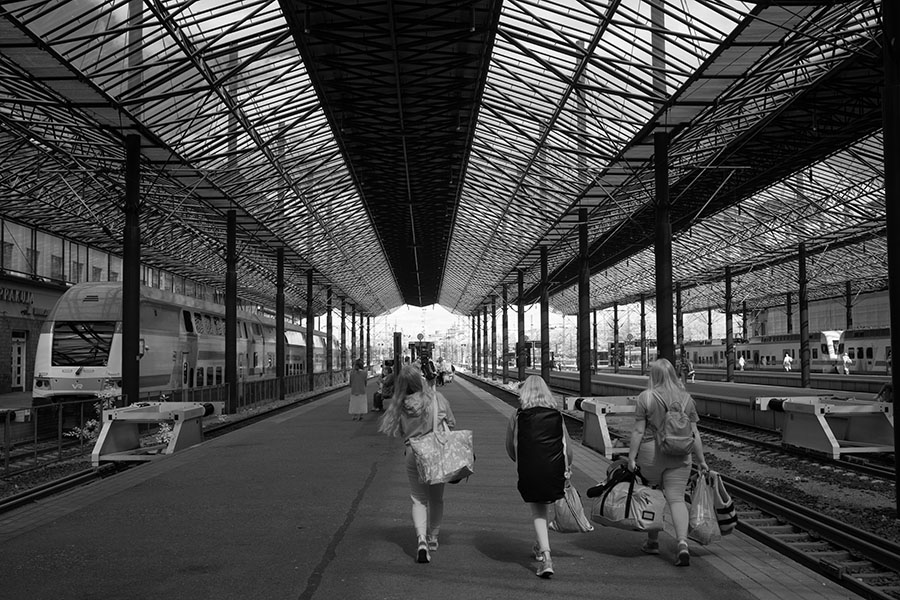 Infrared Photograph of Small Group Walking Down the Platform in Helsinki Train Station.