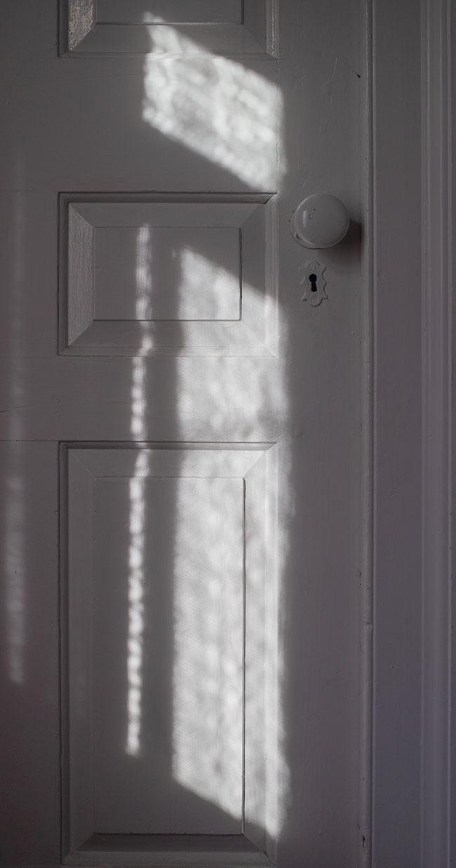 New England Federal House Interior Door with Splach of Window Light.