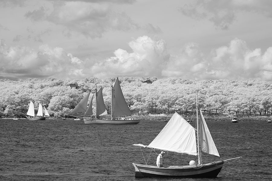Infrared Photo of Small Boat in Front of Schooner in Gloucester Outer Harbor.