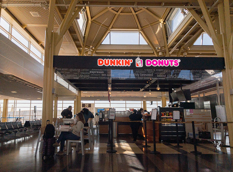 Dunkin' Donuts Stand at Modern Airport