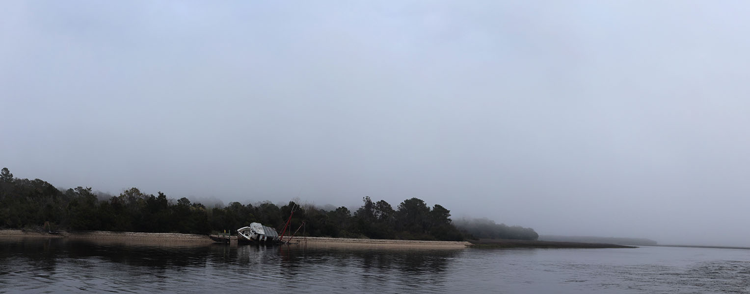 Foggy Coastline with Wrecked Fishing Boat