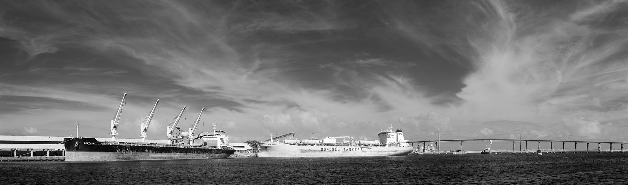 Infrared Panorama of Bulk Carrying Ships at Wharf with Dramatic Sky