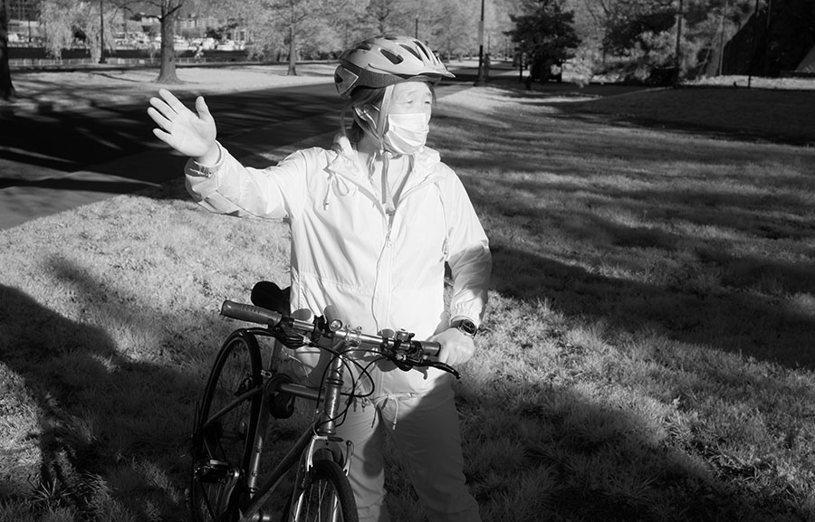 Infrared Portrait of Masked Woman With Her Bicycle.